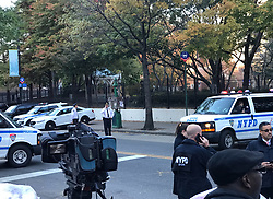 October 31, 2017 - New York, New York, U.S. - NYPD Police officers near the site of a shooting in lower Manhattan. 7 people are dead after a truck driver made a 'purposeful turn' onto a jogging and biking path. The sprawling crime scene runs several blocks along the West Side Highway, a few blocks away from One World Trade Center. A Home Depot rental truck, entered the West Street pedestrian and bike path north of Chambers Street, hitting multiple people on the path, the vehicle kept driving south until it hit another vehicle. At that point, the suspect, who was 'displaying imitation firearms,' got out of the vehicle and was shot by responding officers. The suspect is in custody, the incident is being investigated as a possible terrorist incident, New York City Police said. (Credit Image: © Sun Oumeng/Xinhua via ZUMA Wire)