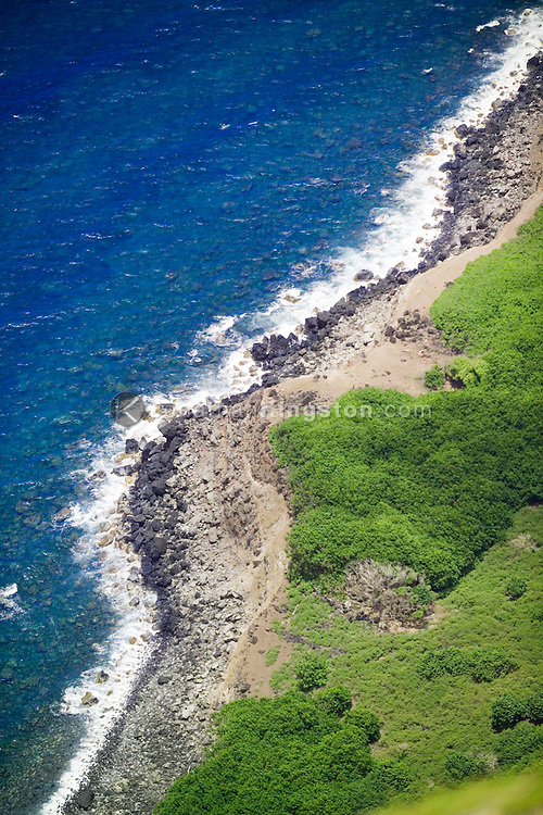 MOLOKAI, HI - A view of the Pacific Ocean and island coastline from the top of the world's highest sea cliffs on Molokai, Hawaii.  The cliffs drop about 1010 meters into the Pacific Ocean at their highest point.