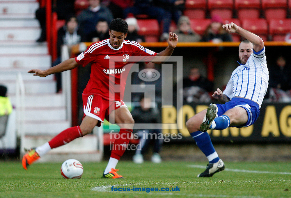 Picture by Daniel Chesterton/Focus Images Ltd. 07966 018899.17/12/11.Jake Jervis of Swindon and Will Haining of Morecambe during the Npower League 2 match at The County Ground, Swindon.