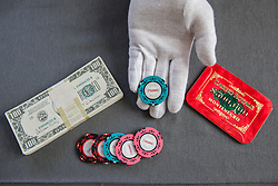 © licensed to London News Pictures. London, UK 28/06/2012. Fake money bills and casino chips which used in Quantum of Solace, estimated to be sold for £500-700 by Bonhams. Photo credit: Tolga Akmen/LNP