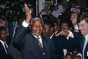 Nelson Mandela greets waves to a crowd outside the Masjid ul-Awwal, Mosque in Cape Town, April 1994.<br /> <br /> Photograph &copy; nic bothma