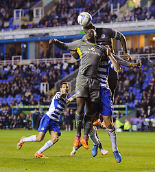Jeffrey Schlupp (GHA) and Wes Morgan (ENG) of Leicester City and Pavel Pogrebnyak (RUS) of Reading compete in the air - Photo mandatory by-line: Rogan Thomson/JMP - 07966 386802 - 14/04/2014 - SPORT - FOOTBALL - Madejski Stadium, Reading - Reading v Leicester City - Sky Bet Football League Championship.