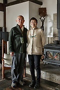 Oiso, Kanagawa prefecture, Japan, February 10 2017 - Keiji and Atsuko Suzuki's minka, traditional wooden house, is the last minka home in Oiso. The previous owner of the 3,000 sq. ft. house moved it from the shores of Lake Biwa, near Kyoto, 35 years ago.<br /> Keiji and Atsuko Suzuki in the living room.