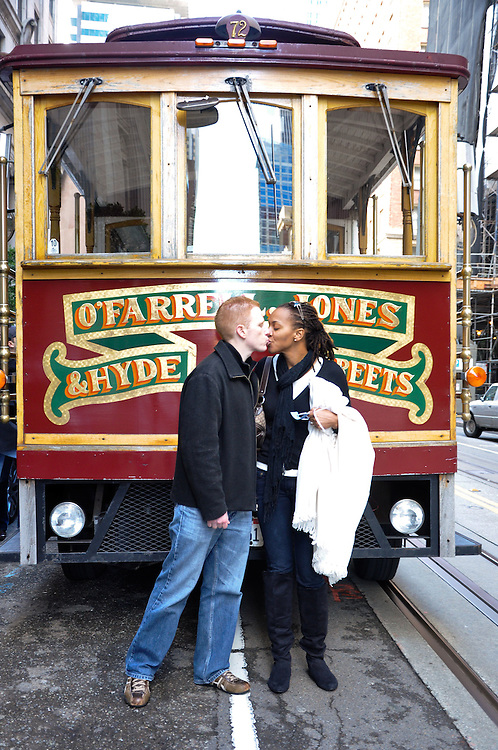 Uzoezi & Noam kiss in front of an iconic San Francisco cable car