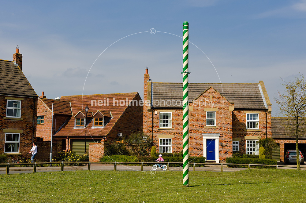 Maypole on the green in Vine Gardens, Bubwith village, East Yorkshire