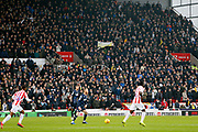 Leeds fans applauding in the 6th minute, in memory of Leeds fan Toby Nye who died at the age of 6, during the EFL Sky Bet Championship match between Stoke City and Leeds United at the Bet365 Stadium, Stoke-on-Trent, England on 19 January 2019.