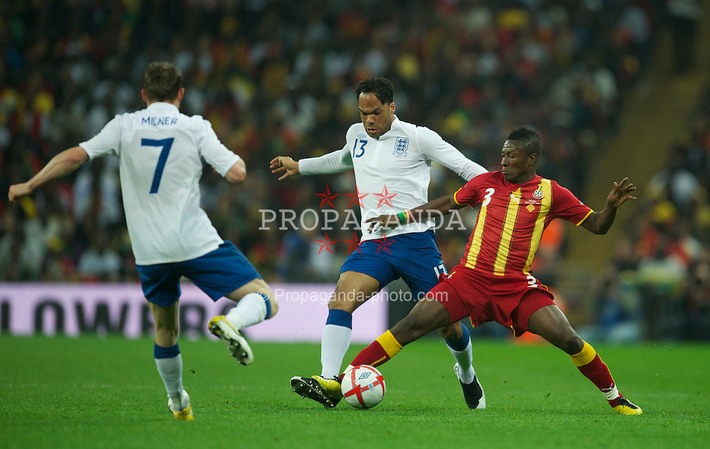 LONDON, ENGLAND - Tuesday, March 29, 2011: England's Joleon Lescott in action against Ghana's Asamoah Gyan during the international friendly match at Wembley Stadium. (Photo by David Rawcliffe/Propaganda)