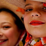 "Elissa Nouguez, 10 (right) and Mimi Galvan, 10 (left), stand with other young dancers after a performance in the main plaza at the historic  Olvera Street in Los Angeles, California, on April 11, 2009. They had just finished performing traditional Mexican folkloric dances with the dance group Ballet Folklorico Mexico Azteca, of Burbank California, in celebration of day of the ""Blessing of the Animals"" event, held annually at Olvera Street. Photo by Jen Klewitz"