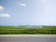 Watering fields with sprinklers. Photographed in Israel