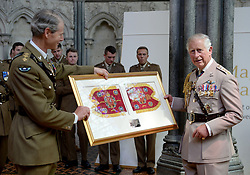 Colonel Commandant of the Army Air Corps , General Sir Adrian Bradshaw (left) presents the Prince of Wales with part of the Army Air Corps guidon, following a consecration service for its new guidon or heraldic banner at Salisbury Cathedral in celebration of the Army Air Corps 60th anniversary.