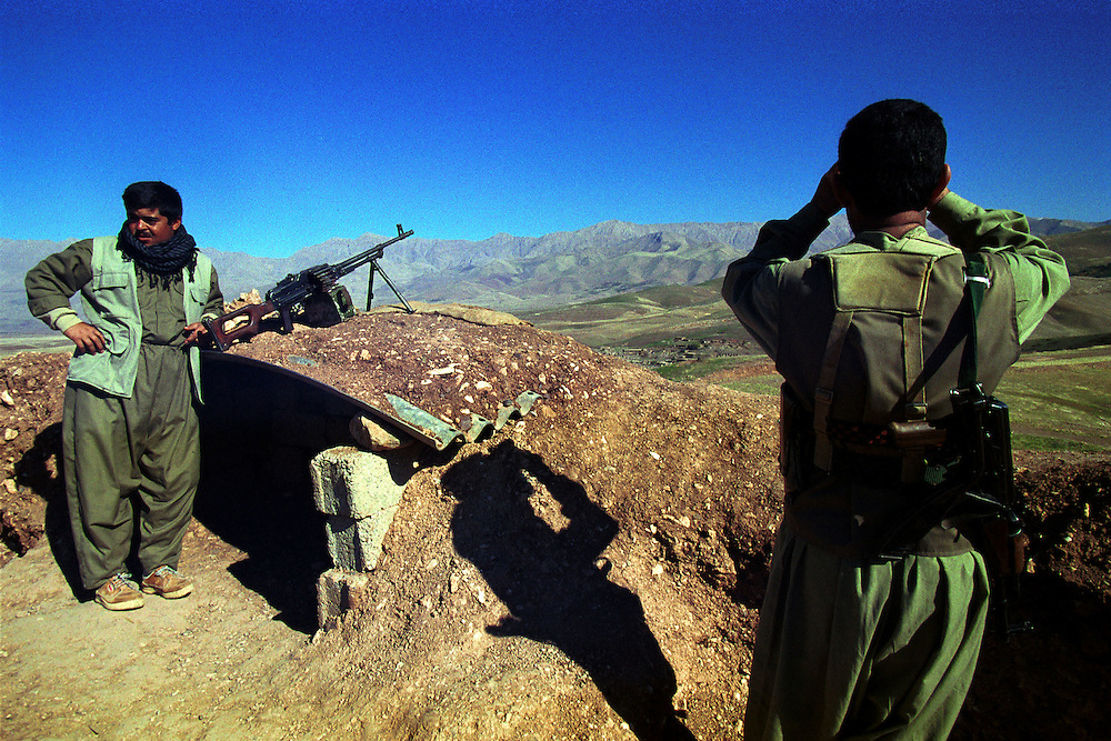 "Peshmerga (meaning ""those who face death"" in Kurdish) fighters atop their mountain positions along the Shinirwe front line with Ansar al-Islam extremists. Ansar al-Islam is a group of Islamic extremists that control a mountainous enclave of Iraqi Kurdish territory along the Iranian border. They have carried out numerous attacks in Iraqi Kurdistan and an assassination attempt against the governor of the Sulaimaniya region. Mortars and gun fire are regularly exchanged with the Peshmerga who try to contain them...Halabja, Iraqi Kurdistan. 20/11/2002...Photo © J.B. Russell"