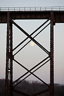 Salisbury Mills, New York - An almost full moon rises behind the Moodna Viaduct railroad trestle on Nov. 20, 2010.
