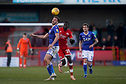 Harry Smith of Macclesfield Town under pressure by Panutche Camara of Crawley Town during the EFL Sky Bet League 2 match between Crawley Town and Macclesfield Town at The People's Pension Stadium, Crawley, England on 23 February 2019.