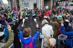 London, UK. 7 October, 2019. Extinction Rebellion drummers block Trafalgar Square on the first day of International Rebellion protests to demand a government declaration of a climate and ecological emergency, a commitment to halting biodiversity loss and net zero carbon emissions by 2025 and for the government to create and be led by the decisions of a Citizens' Assembly on climate and ecological justice.