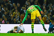 West Bromwich Albion forward Hal Robson-Kanu (4) reacts after fouling Leeds United defender Liam Cooper (6) during the EFL Sky Bet Championship match between Leeds United and West Bromwich Albion at Elland Road, Leeds, England on 1 October 2019.