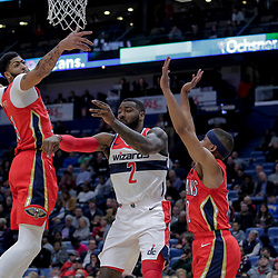 Nov 28, 2018; New Orleans, LA, USA; Washington Wizards guard John Wall (2) passes as New Orleans Pelicans forward Anthony Davis (23) and guard Tim Frazier (10) defend during the second quarter at the Smoothie King Center. Mandatory Credit: Derick E. Hingle-USA TODAY Sports
