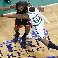 03 June 2012: Boston Celtics point guard Keyon Dooling (51) reaches for the ball on Miami Heat point guard Mario Chalmers (15) during the Boston Celtics 93-91 overtime victory over the Miami Heat, in Game 4 of the Eastern Conference Finals playoff series, at the TD Banknorth Garden, Boston, Massachusetts, USA.