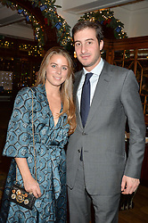 LONDON, ENGLAND 1 DECEMBER 2016: Lydia Forte, Dimitri Chandris Left to right, at the Smythson & Brown's Hotel Christmas Party held at Brown's Hotel, Albemarle St, Mayfair, London, England. 1 December 2016.