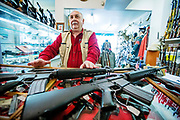 David Petronis behind two AR 15 machineguns with 30 round magazines. David and his wife Kathy Petronis runs the gun store New Eastcoast Arms Colleictors Associates n Mechanicville.  Just days before the New York State passed sweeping changes to their gun law, Petronis hosted a Gun Show where AR-15 machineguns and 30 round magatzines sold like hotcakes. The Petronis have seen a surge of customers since the Newtown massacre.