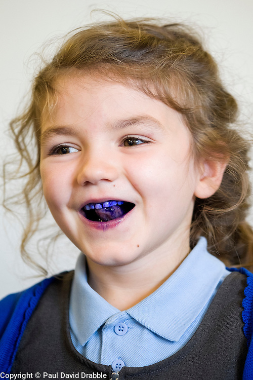Hunloke Park Primary School Pupil Margot after using a disclosure tablet to reveal plaque in the mouth during the Oasis  oral hygiene session on Tuesday<br /> 20 October 2015<br />  Image © Paul David Drabble <br />  www.pau ldaviddrabble.co.uk