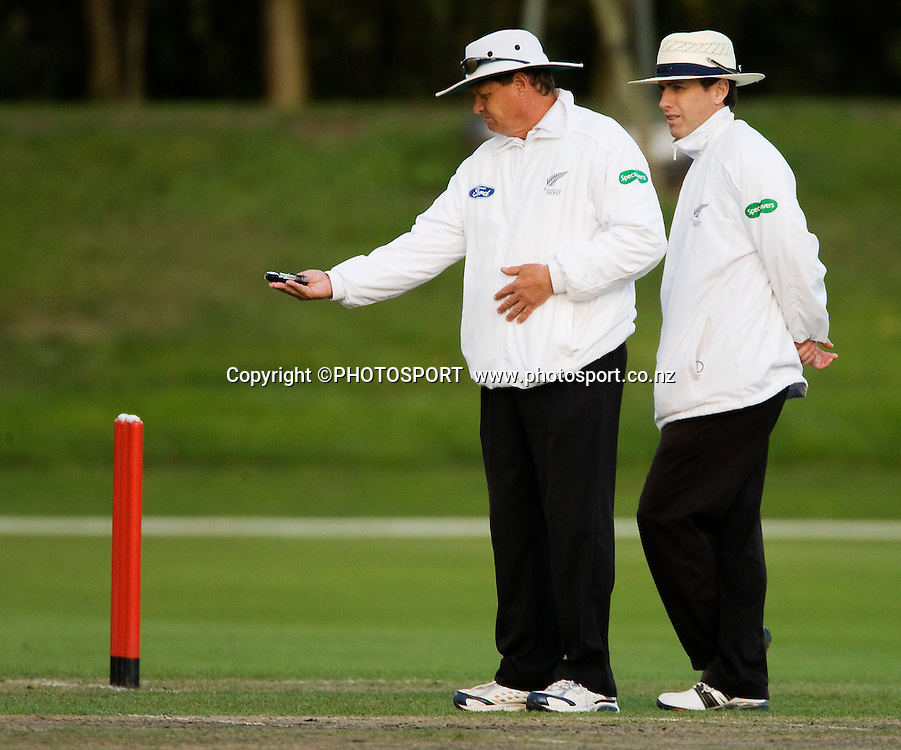 Umpires Phil Jones and Chris Gaffaney call bad light which ended play on day two. Canterbury Wizards v Northern Knights, Plunket Shield Game held at Mainpower Oval, Rangiora, Tuesday 05 April 2011. Photo : Joseph Johnson / photosport.co.nz