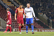Bury forward Leon Clarke  has a joke with Bradford City defender James Meredith  during the The FA Cup match between Bradford City and Bury at the Coral Windows Stadium, Bradford, England on 19 January 2016. Photo by Simon Davies.