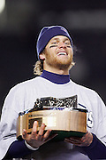 PITTSBURGH - JANUARY 23:  Quarterback Tom Brady #12 of the New England Patriots holds the AFC Lamar Hunt Trophy on the postgame awards stage after the Patriots win over the Pittsburgh Steelers in the AFC Championship game at Heinz Field on January 23, 2005 in Pittsburgh, Pennsylvania. The Pats defeated the Steelers 41-27. ©Paul Anthony Spinelli  *** Local Caption *** Tom Brady