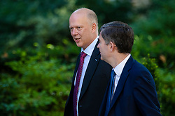 © Licensed to London News Pictures. 17/07/2018. London, UK. Transport Secretary Chris Grayling (L) and Justice Secretary David Gauke (R) arrive on Downing Street for the Cabinet meeting. Photo credit: Rob Pinney/LNP