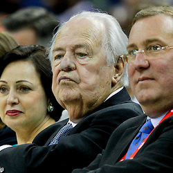 October 9, 2012; New Orleans, LA, USA; New Orleans Hornets and New Orleans Saints owner Tom Benson (center) with his wife Gayle Benson (left) and team president Dennis Lauscha (right) during the second half of a preseason game against the Charlotte Bobcats at the New Orleans Arena. The Hornets defeated the Bobcats 97-82.  Mandatory Credit: Derick E. Hingle-US PRESSWIRE