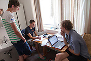 De trainers van de VU (vlnr Ivo, Niels en Josh) bespreken het protocol. Het Human Power Team Delft en Amsterdam (HPT), dat bestaat uit studenten van de TU Delft en de VU Amsterdam, is in Senftenberg voor een poging het uurrecord te verbreken op de Dekrabaan met de VeloX4. In september wil het HPT daarna een poging doen het wereldrecord snelfietsen te verbreken, dat nu op 133 km/h staat tijdens de World Human Powered Speed Challenge.<br /> <br /> Trainers Ivo, Niels and Josh (left to right) discus the protocol of the record attempt. The Human Power Team Delft and Amsterdam, consisting of students of the TU Delft and the VU Amsterdam, is in Senftenberg (Germany) for the attempt to set a new hour record on a bicycle with the special recumbent bike VeloX4. They also wants to set a new world record cycling in September at the World Human Powered Speed Challenge. The current speed record is 133 km/h.