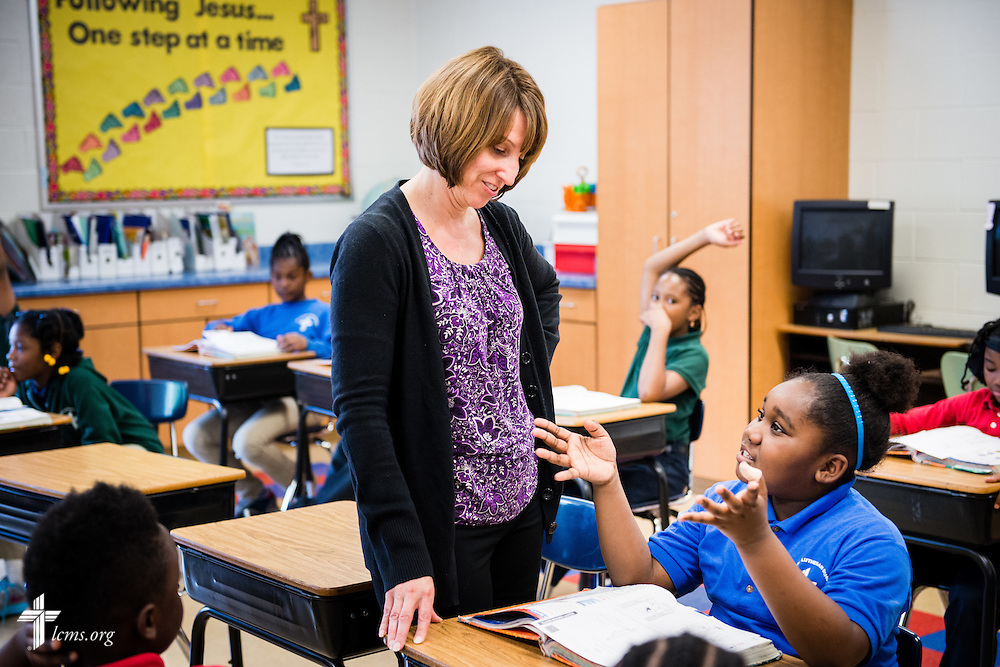 Teacher Sherry Williams talks with Gia during class at Mount Calvary Lutheran School on Wednesday, May 28, 2014, in Milwaukee, Wis. LCMS Communications/Erik M. Lunsford