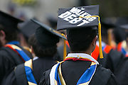 "George Iwaoka of Cliffside Park, New Jersey wears a cap that says ""The Walking Debt"" at the University of Rochester's Commencement ceremony in Rochester on Sunday, May 15, 2016."