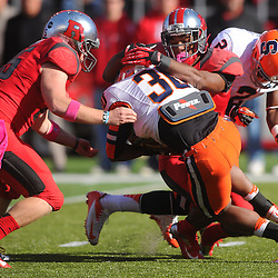 Oct 13, 2012: Syracuse Orange running back Steve Rene (30) is tackled by Rutgers Scarlet Knights long snapper Robert Jones (85) and Rutgers Scarlet Knights defensive back Logan Ryan (11) during NCAA Big East college football action between the Rutgers Scarlet Knights and Syracuse Orange at High Point Solutions Stadium in Piscataway, N.J.