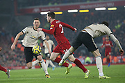Liverpool defender Andrew Robertson (26) goes thropugh the middle of the Manchester United defence during the Premier League match between Liverpool and Manchester United at Anfield, Liverpool, England on 19 January 2020.