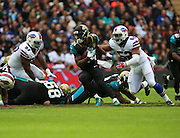 Jacksonville Jaguars T.J. Yeldon about to get smothered by Buffalo Bills Nigel Bradham during the Buffalo Bills v Jacksonville Jaguars NFL International Series match at Wembley Stadium, London, England on 25 October 2015. Photo by Matthew Redman.