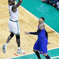 26 April 2013: Boston Celtics center Kevin Garnett (5) takes a jumpshot over New York Knicks small forward Carmelo Anthony (7) during Game Three of the Eastern Conference Quarterfinals of the 2013 NBA Playoffs at the TD Garden, Boston, Massachusetts, USA.
