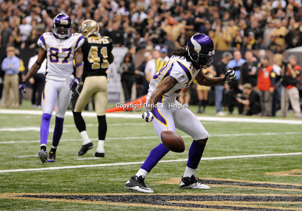 Jan 24, 2010; New Orleans, LA, USA; Minnesota Vikings wide receiver Sidney Rice (18) celebrates after a touchdown during a 31-28 overtime victory by the New Orleans Saints over the Minnesota Vikings in the 2010 NFC Championship game at the Louisiana Superdome. Mandatory Credit: Derick E. Hingle-US PRESSWIRE