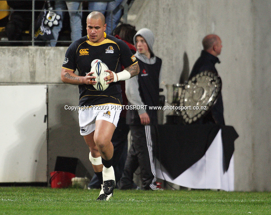 Wellington's John Schwalger brings the ball out past the Ranfurly Shield.<br /> Air NZ Cup Ranfurly Shield match - Wellington Lions v Canterbury at Westpac Stadium, Wellington, New Zealand. Saturday, 29 August 2009. Photo: Dave Lintott/PHOTOSPORT