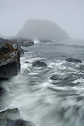 A wave splashes the shoreline at Point St. George near Crescent City, California