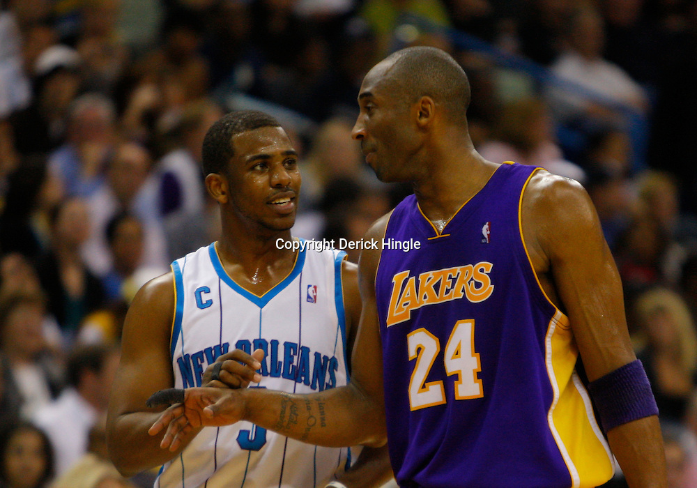 Mar 29, 2010; New Orleans, LA, USA; New Orleans Hornets guard Chris Paul (3) talks with Los Angeles Lakers guard Kobe Bryant (24) during the second half at the New Orleans Arena. Mandatory Credit: Derick E. Hingle-US PRESSWIRE