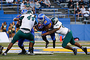 San Jose State Spartans running back JASON SIMPSON (32) breaks through tackles by Sacramento State Hornets defensive lineman DARNELL SANKEY (44) and linebacker TODD DAVIS (53) during the season opener at San Jose State University's Spartan Stadium in San Jose, California, on August 29, 2013.  The San Jose State Spartans beat the Sacramento State Hornets 24-0. (Stan Olszewski/ZUMA Press)
