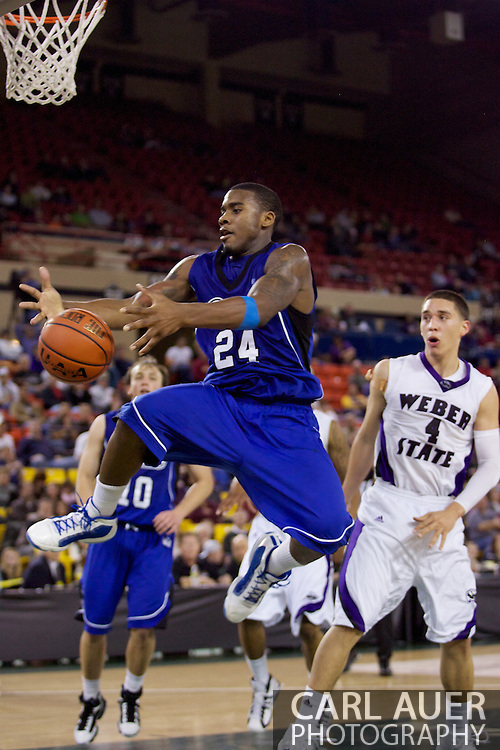 November 27th, 2010:  Anchorage, Alaska - Drake Bulldog Rayvonte Rice (24) attempts to grab a rebound in the Bulldog 81-82 loss to Weber State in the third place game of the Great Alaska Shootout.