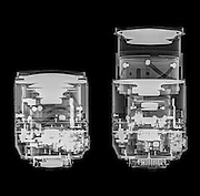 Camera lens under x-ray. the optical elements can be seen. Nikkor 18-105mm zoomed to 18mm (left) and 105mm (right)