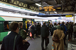 © Licensed to London News Pictures. 15/12/2016. LONDON, UK.  Commuters queue to board a Southern Rail train at Clapham Junction station in London during the rush hour this morning. Southern Railway services have been reduced today following a two day all-out strike by RMT and Aslef trade union members because of a dispute about the role of conductors, which ended at midnight. Talks are now underway at the conciliation service Acas to try and resolve the dispute over driver-only trains ahead of another all-out strike on Friday.  Photo credit: Vickie Flores/LNP