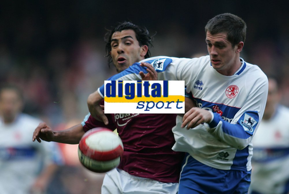 Photo: Lee Earle.<br /> West Ham United v Middlesbrough. The Barclays Premiership. 31/03/2007.United's Carlos Tevez (L) battles with Andrew Taylor.