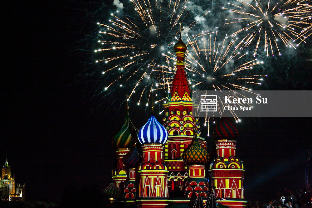Night view of fireworks over St. Basil's Cathedral in Red Square, Moscow, Russia
