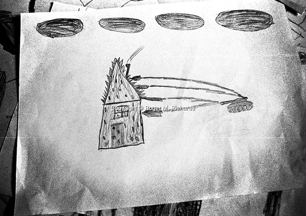 A child's drawing depicts a Serb tank firing at a house, Sarajevo, Bosnia-Herzegovina, February 1993. PHOTO BY ROGER RICHARDS
