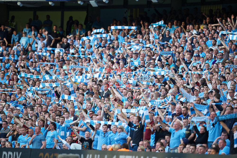 MANCHESTER, ENGLAND - Sunday, September 22, 2013: Manchester City supporters during the Premiership match against Manchester United at the City of Manchester Stadium. (Pic by David Rawcliffe/Propaganda)