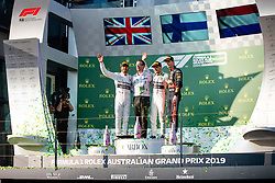March 17, 2019 - Albert Park, VIC, U.S. - ALBERT PARK, VIC - MARCH 17: L-R Second place Mercedes-AMG Petronas Motorsport driver Lewis Hamilton (44), Mercedes Head of Vehicle Dynamics Loic Serra, winner Mercedes-AMG Petronas Motorsport driver Valtteri Bottas (77) and Aston Martin Red Bull Racing driver Max Verstappen (33) on the podium at The Australian Formula One Grand Prix on March 17, 2019, at The Melbourne Grand Prix Circuit in Albert Park, Australia. (Photo by Speed Media/Icon Sportswire) (Credit Image: © Steven Markham/Icon SMI via ZUMA Press)