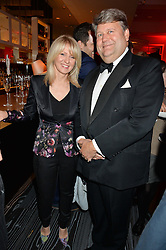 ESTHER McVEY and LORD STRATHCLYDE at a party to celebrate the 21st anniversary of The Roar Group hosted by Jonathan Shalit held at Avenue, 9 St.James's Street, London on 21st September 2015.
